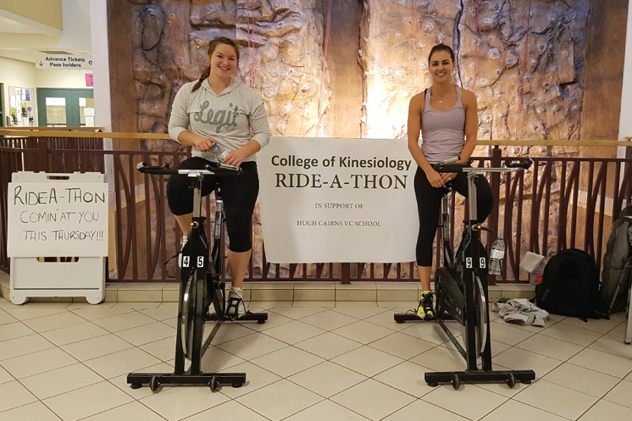 Professor Marta Erlandson (right) and kinesiology student leader Emmarae Dale (left) take a quick sponsored break during their turn on the bikes.