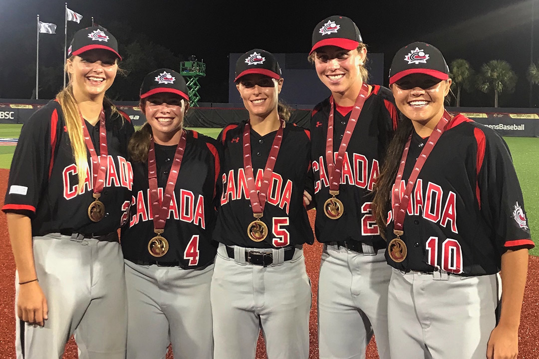 Kelsey Lalor (second from right) and her Canadian teammates with their bronze medals from the world baseball championship in August.